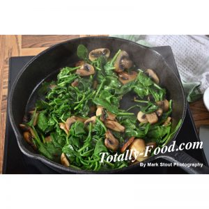 spinach and mushrooms stock photo